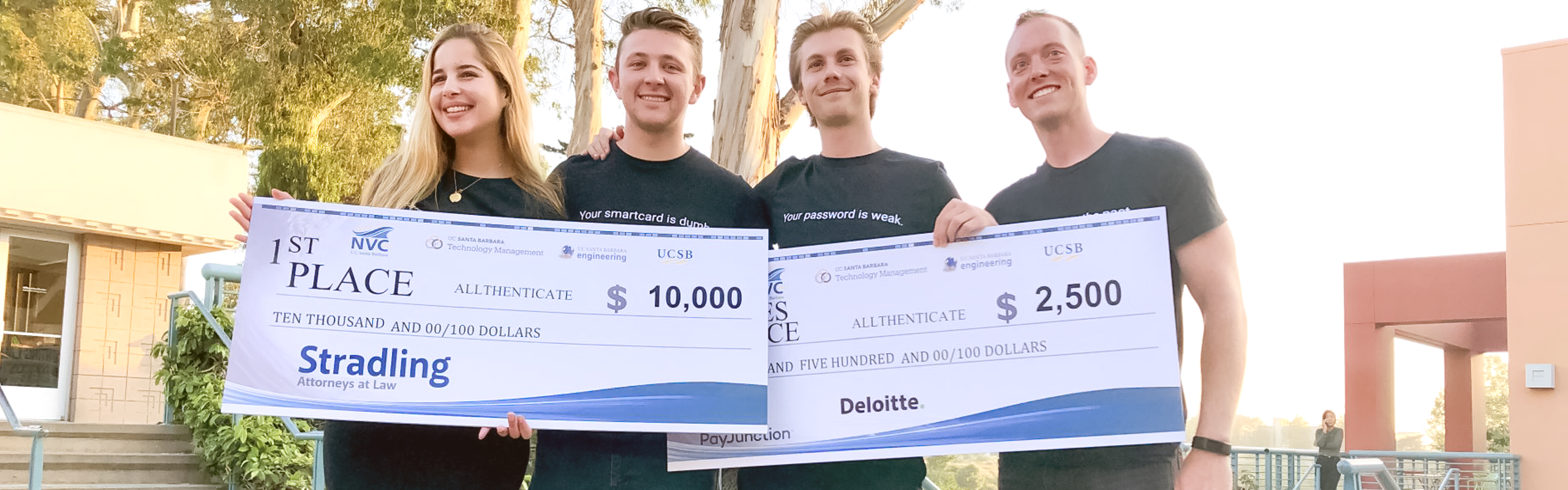 Allthenticate holding award checks at the 2019 New Venture Competition at UCSB